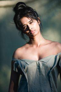 Model Saraiya in linen dress, photographed by Dave Blake. Hair and Makeup Nahid Kholghi
